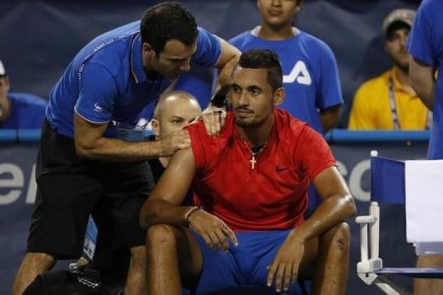 Kyrgios retires with shoulder injury, booed in D.C