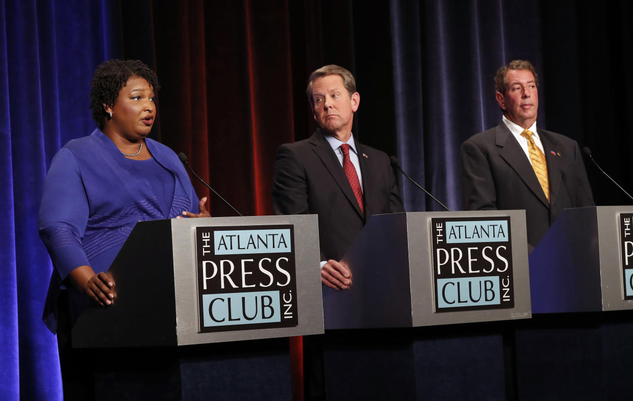 Abrams speaks as Republican Secretary of State Brian Kemp and libertarian candidate Ted Metz, right, listen during the gubernatorial debate on Oct. 23, 2018. (Photo: John Bazemore/Pool/AP)