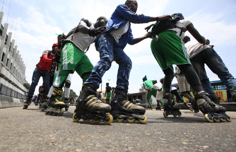 Skaters perform, during an event to mark Nigeria's independence day in Lagos, Nigeria. Tuesday, Oct. 1, 2013 . Nigeria marked 53 years of independence Tuesday with little to celebrate, scores of families are in mourning over killings by suspected Islamic extremists, security forces on high alert against feared bomb attacks and the government rift by an internal power struggle. (AP Photo/Sunday Alamba)