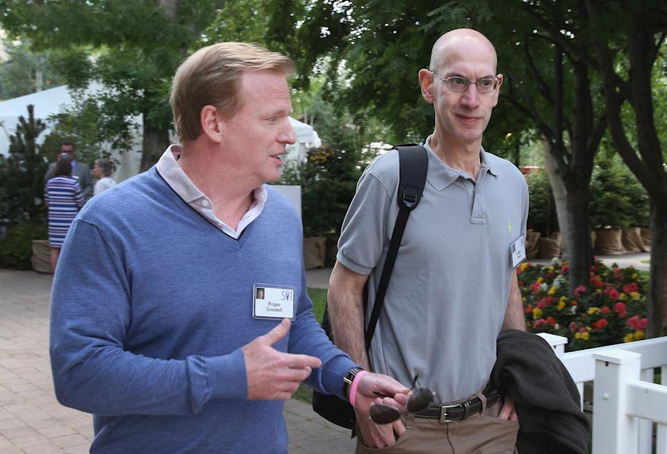 NFL commissioner Roger Goodell and NBA commissioner Adam Silver have taken different approaches to the coronavirus pandemic. (Scott Olson/Getty Images)
