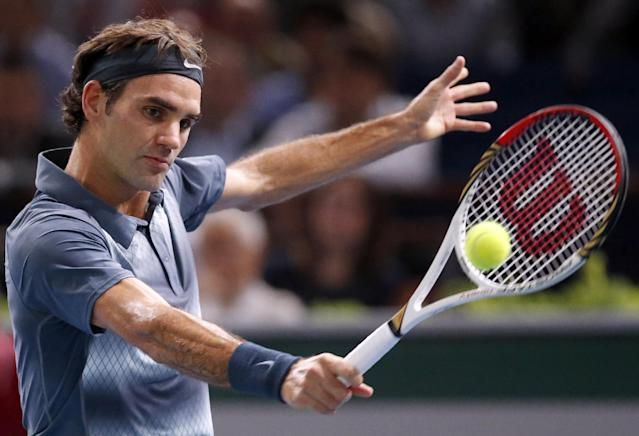 Roger Federer of Switzerland returns the ball to Novak Djokovic of Serbia during their semi final match, at the Paris Masters tennis at Bercy Arena in Paris, France, Saturday, Nov. 2, 2013. (AP Photo/Francois Mori)