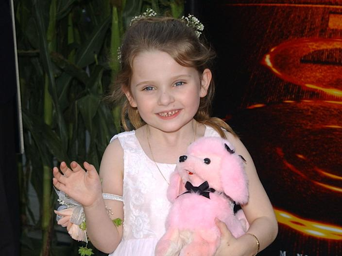 Abigail Breslin brings a stuffed animal to the red carpet in 2002.
