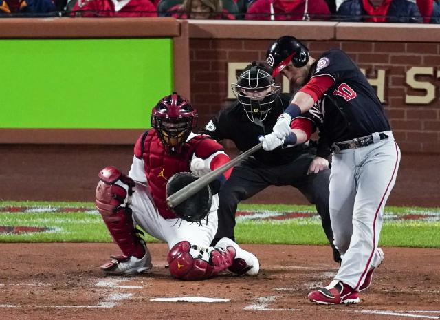 Washington Nationals' Yan Gomes hits an RBI double during the second inning of Game 1 of the baseball National League Championship Series against the St. Louis Cardinals Friday, Oct. 11, 2019, in St. Louis. (AP Photo/Charlie Riedel)