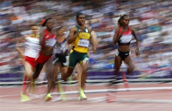 South Africa's Caster Semenya (C) runs with other competitors in her women's 800m semi-final during the London 2012 Olympic Games at the Olympic Stadium August 9, 2012.