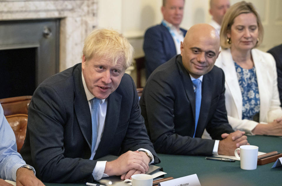 Britain's newly appointed Prime Minister Boris Johnson, left, holds his first Cabinet meeting, with Chancellor of the Exchequer Sajid Javid and Secretary for Work and Pensions Amber Rudd, right, at Downing Street in London, Thursday July 25, 2019. Johnson held his first Cabinet meeting Thursday as prime minister, pledging to break the Brexit impasse that brought down predecessor Theresa May.(Aaron Chown/Pool via AP)