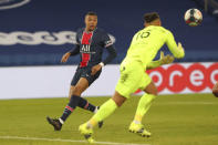 Montpellier's goalkeeper Dimitry Bertaud block a shot by PSG's Kylian Mbappe during the French League One soccer match between Paris Saint-Germain and Montpellier at the Parc des Princes stadium in Paris, France, Friday, Jan.22, 2021. (AP Photo/Thibault Camus)