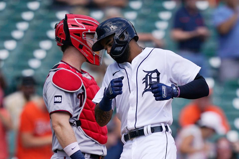 Tigers center fielder Derek Hill passes Twins catcher Ryan Jeffers after a solo home run during the third inning on Monday, Aug. 30, 2021, at Comerica Park.