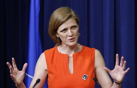 U.S. Ambassador to the UN Samantha Power speaks before she helps unveiling the Harvey Milk Forever Stamp at its dedication ceremony at the White House in Washington May 22, 2014. The ceremony marks the first day of issue for the stamp honoring Milk. REUTERS/Larry Downing