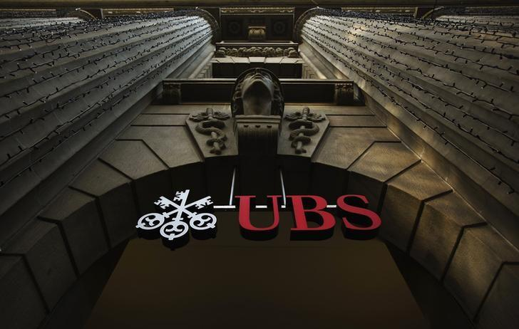 A file photo shows the logo of Swiss bank UBS on a building in Zurich