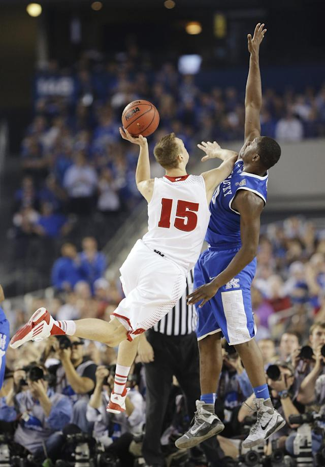 Wisconsin forward Sam Dekker (15) shoots as Kentucky forward Julius Randle (30) defends during the first half of the NCAA Final Four tournament college basketball semifinal game Saturday, April 5, 2014, in Arlington, Texas. (AP Photo/Eric Gay)