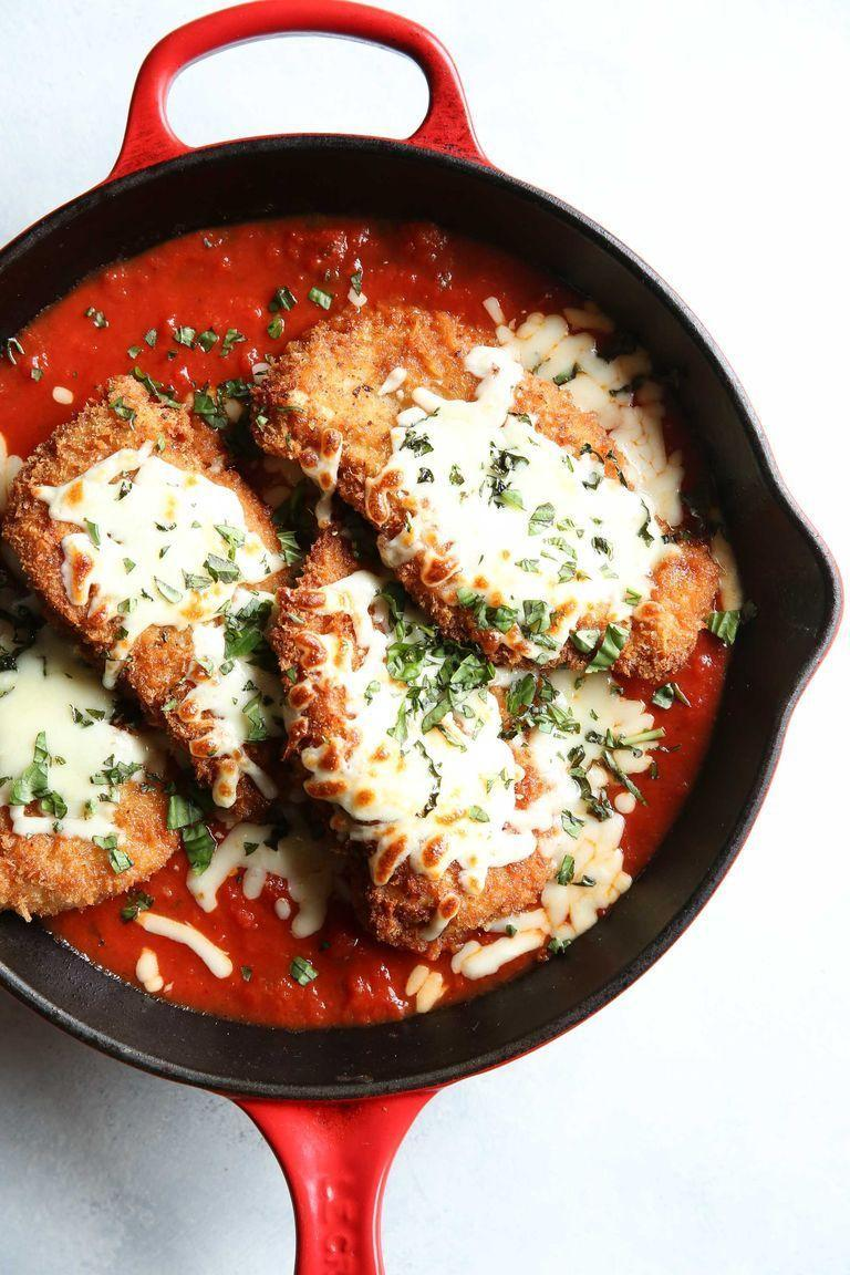 """<p>There are hundreds (maybe thousands) of chicken parm recipes in the world, but this one is our favourite. It's easy, simple, and classic. When you're craving chicken Parmesan, this is exactly what you want. </p><p>Get the <a href=""""https://www.delish.com/uk/cooking/recipes/a29029898/easy-chicken-parmesan-recipe/"""" rel=""""nofollow noopener"""" target=""""_blank"""" data-ylk=""""slk:Chicken Parmesan Recipe"""" class=""""link rapid-noclick-resp"""">Chicken Parmesan Recipe</a> recipe. </p>"""