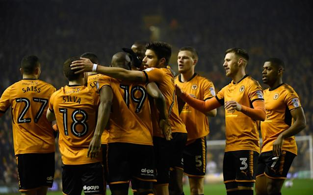 Wolves secured a return to the Premier League without kicking a ball on Saturday after Brentford stole a dramatic 1-1 draw at promotion-chasing Fulham. The Cottagers needed a win in the late kick-off to regain second place from Cardiff in the Sky Bet Championship and to deny Wolves a top-flight spot for the first time since 2012. Aleksandar Mitrovic's 70th-minute goal had looked like putting Wolves' party on hold but Neal Maupay's last-gasp header for Brentford sent Nuno Espirito Santo's side up. Wolves can celebrate at home to Birmingham on Sunday, but third-placed Fulham will have to gather themselves after falling a point and a place behind Cardiff - who have a game in hand. The Bluebirds left it late but kept themselves on course for an automatic promotion place with a 2-0 win at Norwich. Neil Warnock's side know three wins from their remaining four games will be enough to join Wolves in the Premier League but they had to dig deep to earn a vital three points at Carrow Road. Kenneth Zohore squeezed the ball past Angus Gunn in the 86th minute before Junior Hoilett's goal in added time ensured Cardiff's two-game losing streak was brought to an end. Junior Hoilett celebrates his injury time goal in Cardiff City's 2-0 win over Norwich Credit: PA Middlesbrough stormed into the play-off places after coming from behind to beat Bristol City 2-1 at the Riverside Stadium. Milan Djuric volleyed the visitors into a 13th-minute lead before George Friend levelled for Boro five minutes later. Daniel Ayala then headed home the winner in the 68th minute, moving Middlesbrough up to fifth while also denting Bristol City's own top-six hopes. Veteran striker Steve Morison struck his fifth goal of the season for Millwall as they came back to draw 1-1 against fellow play-off hopefuls Sheffield United in the early kick-off. Leon Clarke opened the scoring for the Blades in the 74th minute, but Morison equalised instantly to grab his side a point. The sixth-placed Lions remain unbeaten in the league since New Year's Day and Sheffield United, who are ninth, have not lost at home since late January. Ryan Sessegnon (L) was unable to help Fulham get all three points against Brentford and Romaine Sawyers (R) Derby slipped out of the top six, but Burton moved off the bottom and to within five points of safety after a 3-1 victory over the Rams at the Pirelli Stadium. Liam Boyce tapped home from close range to put the hosts in front after 24 minutes, but their lead did not last long as David Nugent equalised moments later. Luke Murphy curled a beautiful effort past Scott Carson to restore the Brewers' lead just before the break and Lucas Akins added a third in the 68th minute. Oli McBurnie's added-time equaliser secured a vital 2-2 draw for Barnsley at home to fellow strugglers Bolton. Gary Gardner scored from 10 yards midway through the first half for the Tykes before Adam Le Fondre levelled from the spot after 82 minutes. Craig Noone thought he had won it for Bolton three minutes later, but McBurnie had the final say to keep Barnsley within two points of the 21st-placed Trotters. Sunderland slipped to the foot of the table and remain six points below Bolton after drawing 2-2 at Reading. Liam Kelly gave the Royals the lead from the penalty spot after Lee Camp brought down Jon Dadi Bodvarsson in the box after 20 minutes. Paddy McNair fired home a stunning equaliser for the Black Cats just after the break before Lee Cattermole's first goal since August 2014 put the visitors in front in the 66th minute. Yann Kermorgant restored parity for Reading with 11 minutes remaining to leave Chris Coleman's side on the brink with three games left. Ben Brereton's late penalty and Joe Lolley's goal in added time secured an unlikely 2-1 win for Nottingham Forest against Ipswich, who had led through Grant Ward's first-half header. Elsewhere, Callum Robinson's double sealed a 2-1 win for Preston against QPR, who had Matt Smith on the scoresheet, while Jordan