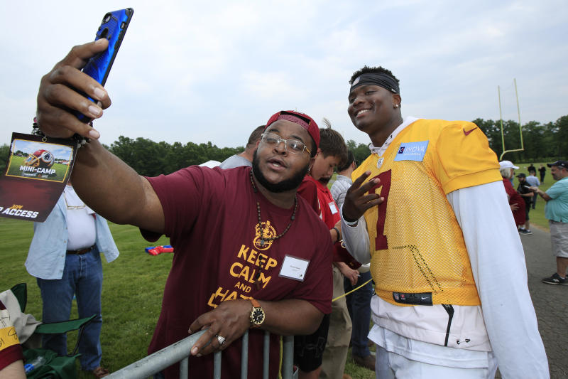 Washington Redskins quarterback Dwayne Haskins Jr., right, poses for a selfie with Redskins fan Davon Adams. (AP)