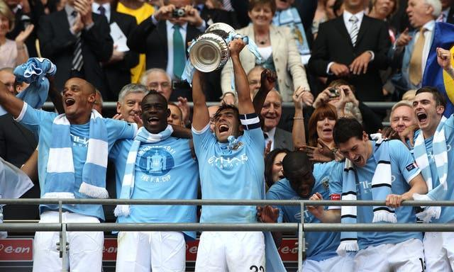 Carlos Tevez, centre, lifted the FA Cup with Manchester City in 2011
