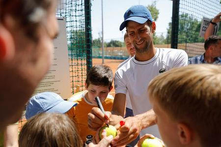 Novak Djokovic of Serbia signs autographs after a training session in Belgrade, Serbia, May 2, 2018. REUTERS/Marko Djurica