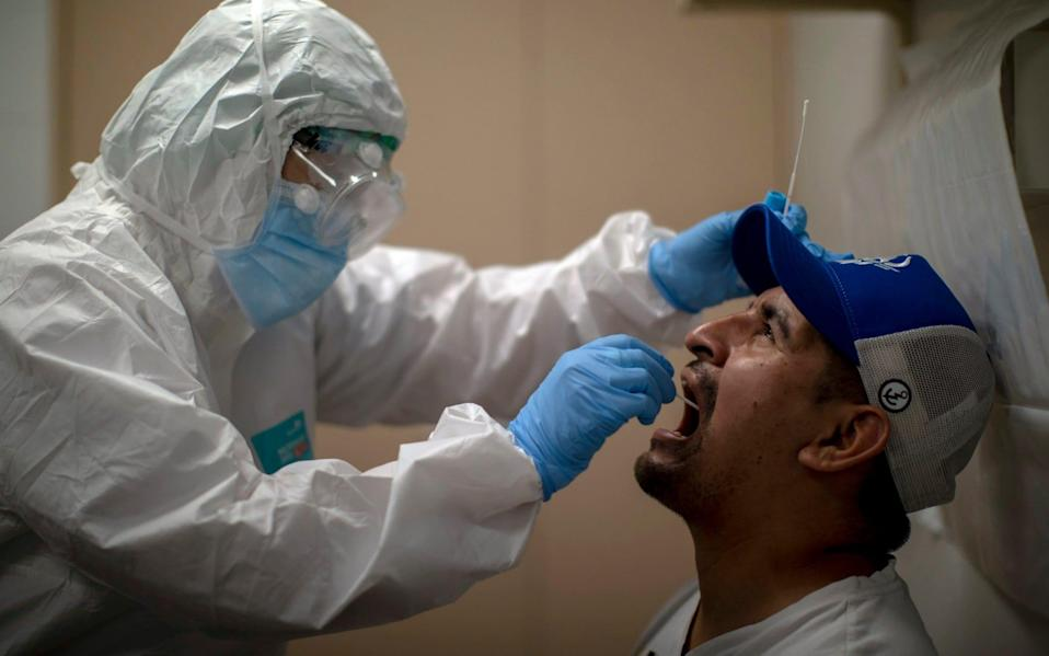 File image of a health worker taking a sample swab to test for coronavirus - AP