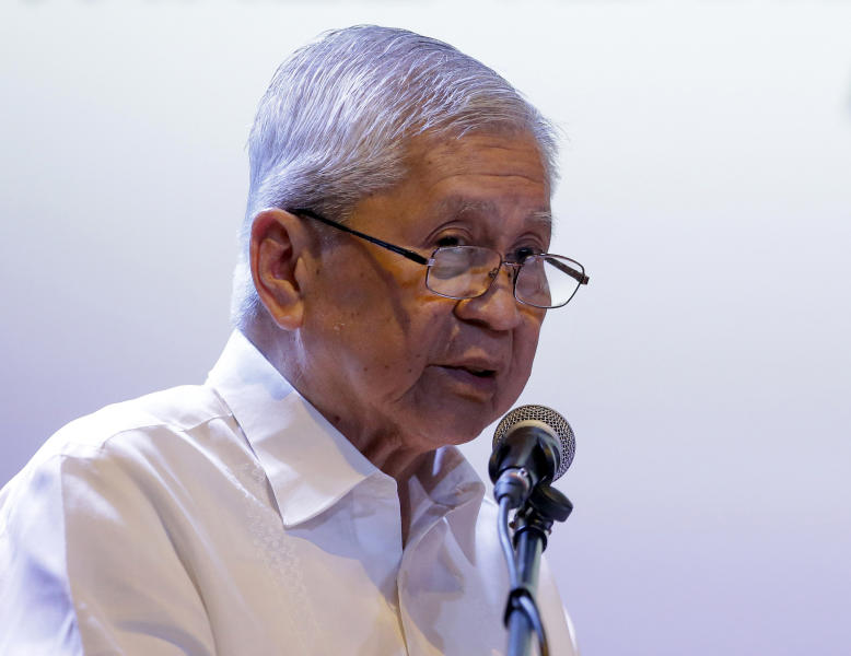 "FILE - In this Friday, July 12, 2019, file photo, former Philippine Foreign Secretary Albert del Rosario delivers his speech during a forum on the South China Sea in metropolitan Manila, Philippines. He said that President Rodrigo Duterte's failure to seek Chinese compliance with an arbitration ruling has resulted in ""more unlawful acts of intimidation and bullying in the South China Sea."" (AP Photo/Aaron Favila, File)"