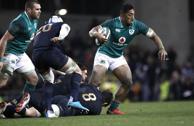 Ireland's Bundee Aki, right, is tackled by Argentina's Tomas Lezana during a rugby union international match at the Aviva stadium in Dublin, Ireland, Saturday, Nov. 25, 2017. (AP Photo/Peter Morrison)