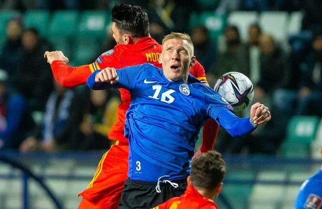 Kieffer Moore, left, fights for the ball with Estonia's Joonas Tamm