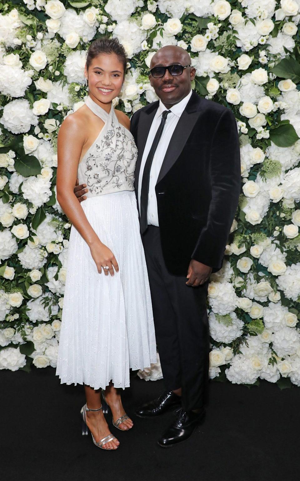 Emma Raducanu at the Vogue x Tiffany LFW party with British Vogue editor Edward Enninful. Emma is wearing jewellery by Tiffany, and a look from Erdem's new collection - Getty