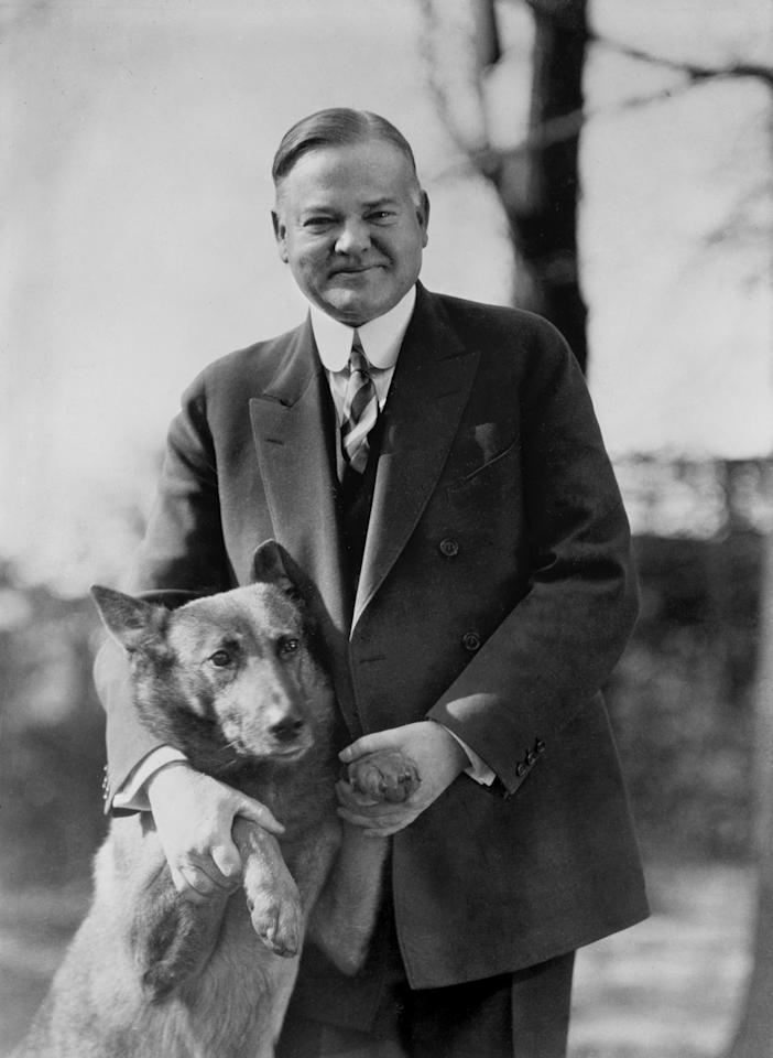 Republican presidential hopeful Herbert Hoover holds his pet dog King Tut ca. 1928. This photo was widely circulated during the 1928 presidential campaign, and some observers credited it with helping boost  Hoover's image in his election win over Democratic candidate Al Smith. (AP Photo/Library of Congress)