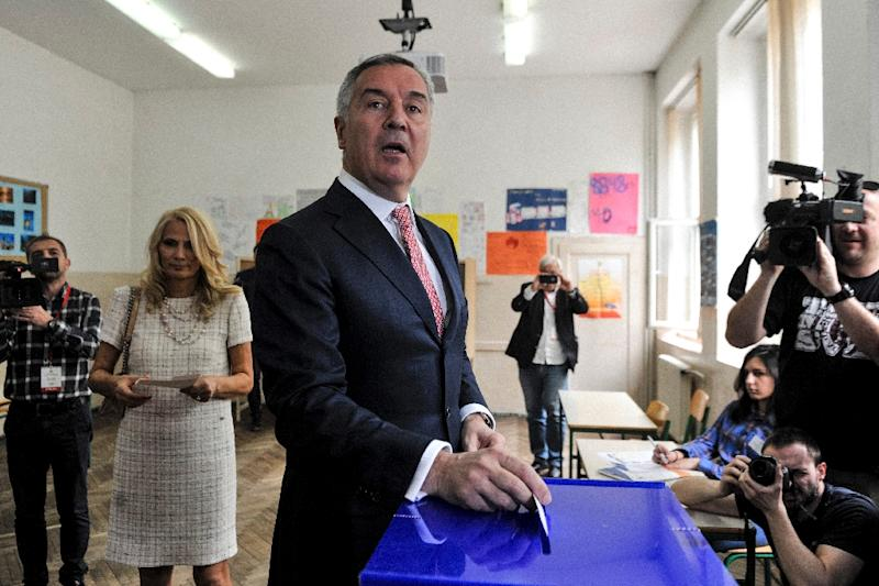 Six-time former prime minister Milo Djukanovic votes in Montenegro's presidential election on Sunday, which is widely expected to win (AFP Photo/SAVO PRELEVIC                       )