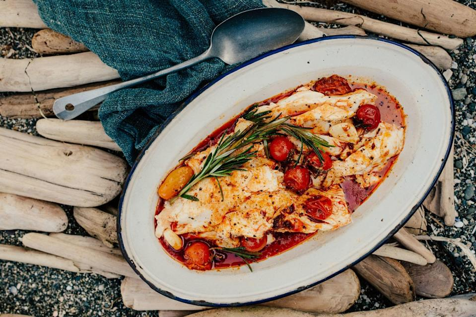 """Give flaky halibut the foil-packet treatment with burst cherry tomatoes and spicy, paprika-loaded sausages. <a href=""""https://www.epicurious.com/recipes/food/views/halibut-with-spicy-nduja-sausage-tomatoes-and-rosemary?mbid=synd_yahoo_rss"""" rel=""""nofollow noopener"""" target=""""_blank"""" data-ylk=""""slk:See recipe."""" class=""""link rapid-noclick-resp"""">See recipe.</a>"""
