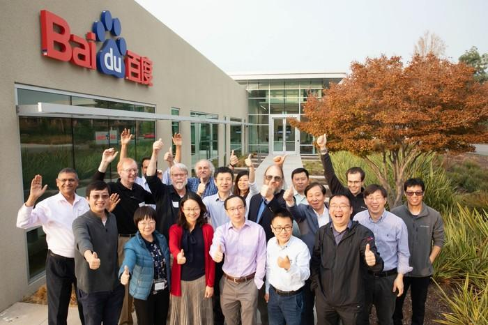 Baidu researchers waving as they pose in front of Baidu offices.