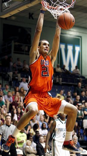 UTEP center John Bohannon (21) dunks the ball against Tulane during the second half of an NCAA college basketball game, Saturday, Jan. 21, 2012, in New Orleans. Tulane won 66-58. (AP Photo/Jonathan Bachman)