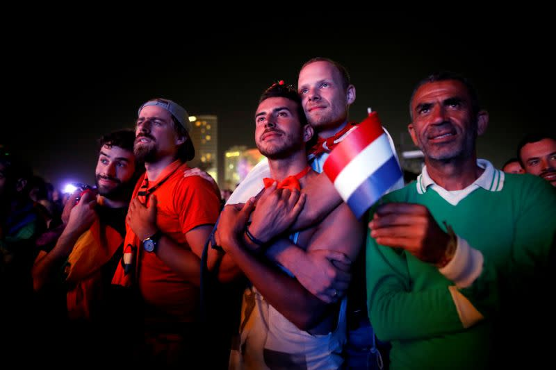 FILE PHOTO: Fans watch on a big screen the 2019 Eurovision song contest final in the fans zone by the beach in Tel Aviv, Israel