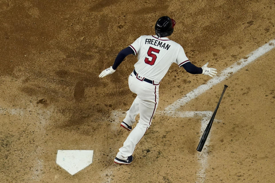 Atlanta Braves' Freddie Freeman watches his RBI-double against the Los Angeles Dodgers during the sixth inning in Game 4 of a baseball National League Championship Series Thursday, Oct. 15, 2020, in Arlington, Texas. (AP Photo/David J. Phillip)