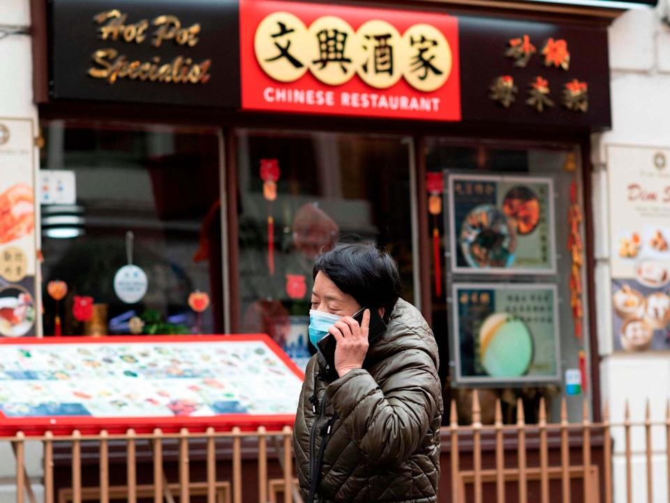 Chinese-owned businesses have taken a hit since coronavirus began spreading worldwide, casting suspicion and fear on Asian communities: AFP via Getty Images