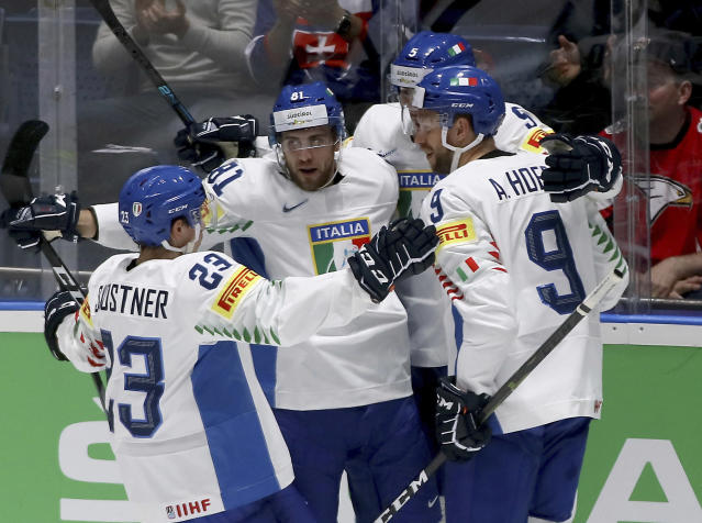 Italy's players celebrate after scoring during the Ice Hockey World Championships group B match between Austria and Italy at the Ondrej Nepela Arena in Bratislava, Slovakia, Monday, May 20, 2019. (AP Photo/Ronald Zak)