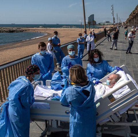"<p>At a hospital in Barcelona, medical staff have been wheeling out recovering Covid-19 patients to be closer to the ocean for short breaks.</p><p><a href=""https://www.instagram.com/p/CA-msPGJyYG/"" rel=""nofollow noopener"" target=""_blank"" data-ylk=""slk:See the original post on Instagram"" class=""link rapid-noclick-resp"">See the original post on Instagram</a></p>"