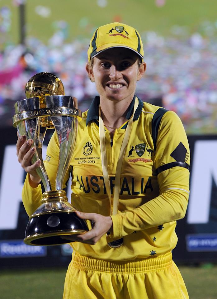 Australian cricket team captain Jodie Fields poses with their Champion's trophy after winning the ICC Women's World Cup 2013 between Australia and West Indies at the Cricket Club of India's Brabourne stadium in Mumbai on February 17, 2013. Australia won the match by 114 runs. AFP PHOTO/Indranil MUKHERJEE