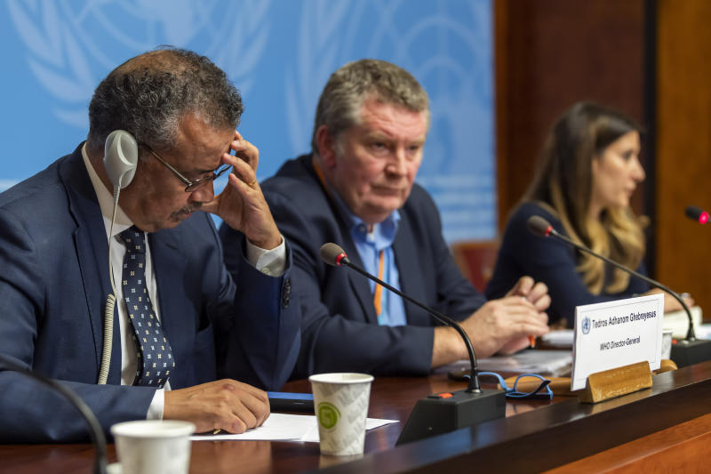WHO executives, from left, Tedros Adhanom Ghebreyesus, Director General of the World Health Organization (WHO) with Michael Ryan, Executive Director, WHO Health Emergencies Programme, and Maria van Kerkhove, Head of the Outbreak Investigation Task Force, during a press conference about the new Coronavirus, at the European headquarters of the United Nations in Geneva, Switzerland, Wednesday, Jan. 29, 2020. Efforts to contain a new and deadly virus have intensified Wednesday, as quarantine facilities are set up, many airlines have suspended or significantly cut back flights from China and efforts continue to find a medical remedy. (Martial Trezzini/Keystone via AP)