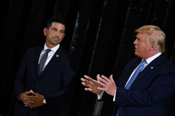 PHOTO: President Donald Trump delivers remarks on immigration and border security as Acting secretary of Homeland Security Chad Wolf looks on at the international airport in Yuma, Ariz., Aug. 18, 2020. (Brendan Smialowski/AFP via Getty Images, FILE)