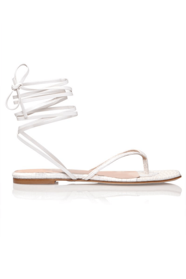 """<p>Brother Vellies Tyla Sandal in Dove, $385, <a href=""""https://brothervellies.com/collections/sandals/products/thong-sandal-in-dove"""" rel=""""nofollow noopener"""" target=""""_blank"""" data-ylk=""""slk:available here"""" class=""""link rapid-noclick-resp"""">available here</a>.</p>"""