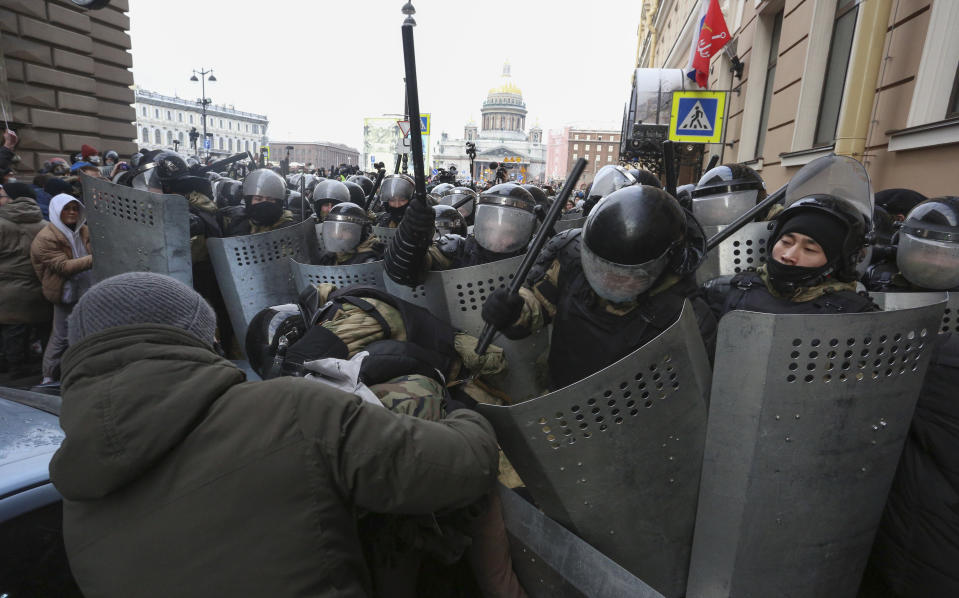 Police stand blocking approaches to the street as protesters try to break through during a protest against the jailing of opposition leader Alexei Navalny in St. Petersburg, Russia, Sunday, Jan. 31, 2021. Thousands of people have taken to the streets across Russia to demand the release of jailed opposition leader Alexei Navalny, keeping up the wave of nationwide protests that have rattled the Kremlin. Hundreds have been detained by police. (AP Photo/Valentin Egorshin)