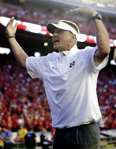 Utah State head coach Gary Andersen rallies his players before the first half of an NCAA college football game against Wisconsin, Saturday, Sept. 15, 2012, in Madison, Wis. (AP Photo/Morry Gash)