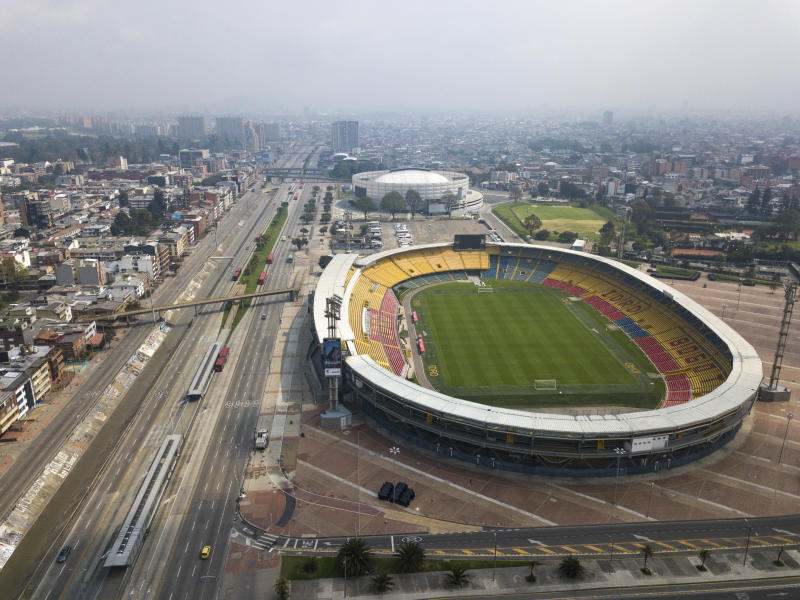 The usually busy avenue running along Nemesio Camacho stadium is empty in Bogota, Colombia, Friday, March 20, 2020. Residents in the capital of Colombia start a four-day simulated home lockdown drill, similar to one surrounding nations are using to stop the spread of the coronavirus. (AP Photo/Ivan Valencia)