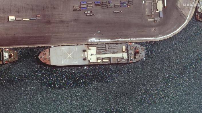 In this satellite photo provided by Maxar Technologies, the Iranian navy vessel Makran is seen at port at Bandar Abbas, Iran, April 28, 2021. An Iranian destroyer and support vessel are now sailing in the Atlantic Ocean in a rare mission far from the Islamic Republic, Iran's state TV reported on Thursday, June 10, 2021, without offering the vessels' final destination. (©2021 Maxar Technologies via AP)