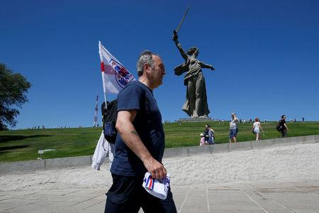 "An England's fan walks near ""The Motherland Calls"" monument at the Mamayev Kurgan World War Two memorial complex in Volgograd, Russia June 18, 2018. REUTERS/Gleb Garanich"