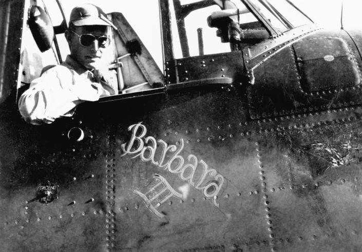 U.S. Navy pilot George Bush, c. 1943-45, in the cockpit of his torpedo bomber Barbara III, named after his girlfriend and future wife. (Photo: Corbis)