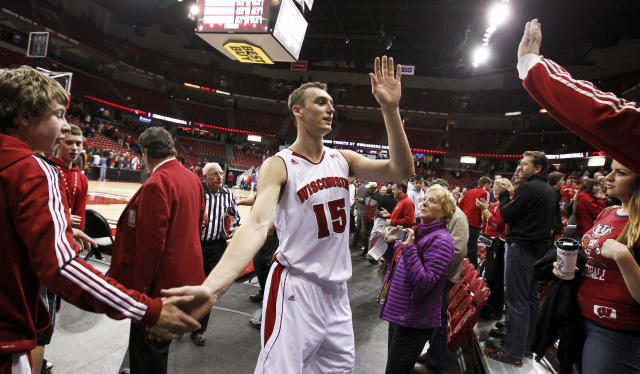 Wisconsin's Sam Dekker is congratulated by fans after Wisconsin defeated Florida 59-53 in an NCAA college basketball game Tuesday, Nov. 12, 2013, in Madison, Wis. (AP Photo/Andy Manis)