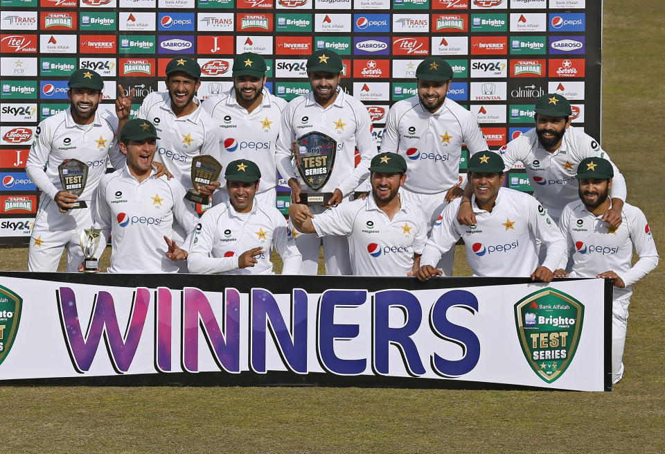 Pakistan's team pose for a photograph with the winning trophy of the test series at the end of the second cricket test match between Pakistan and South Africa at the Pindi Stadium in Rawalpindi, Pakistan, Monday, Feb. 8, 2021. (AP Photo/Anjum Naveed)