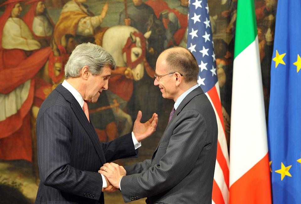 US Secretary of State John Kerry, left, is welcomed by Italian Prime Minister Enrico Letta at the Palazzo Chigi in Rome on Thursday May 9, 2013. (AP Photo/Mladen Antonov)