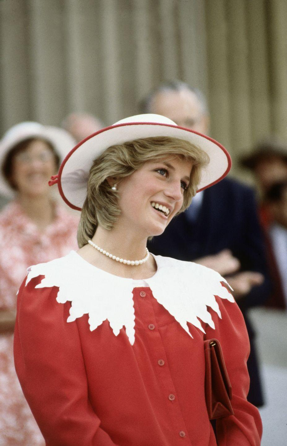 <p>During the Royal Tour of Canada in 1983, Diana donned a red frock with a scalloped and oversized pilgrim collar. </p>