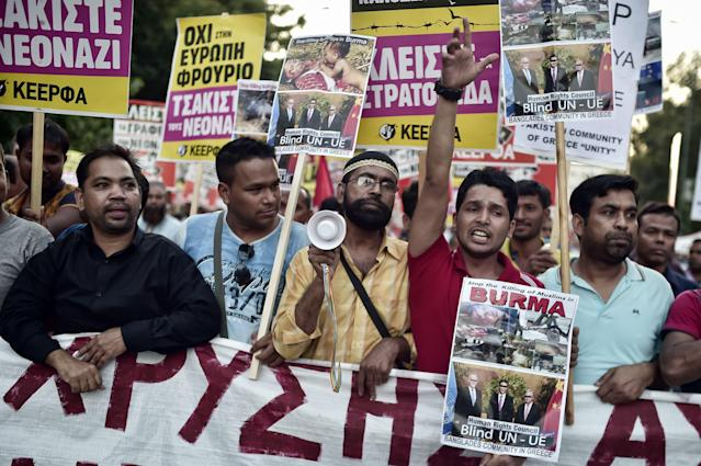 <p>Bangladeshi and Pakistani migrants to Greece along with Greek protesters hold banners against the killing of the Rohingya people in Myanmar as they participate in an anti fascism demonstration in Athens on Sept. 16, 2017. Hundreds of people joined an anti-racism protest in Athens held to commemorate the shock murder of an anti-fascist rapper in 2013 by a member of the neo-Nazi party Golden Dawn. (Photo: Louisa Gouliamaki/AFP/Getty Images) </p>