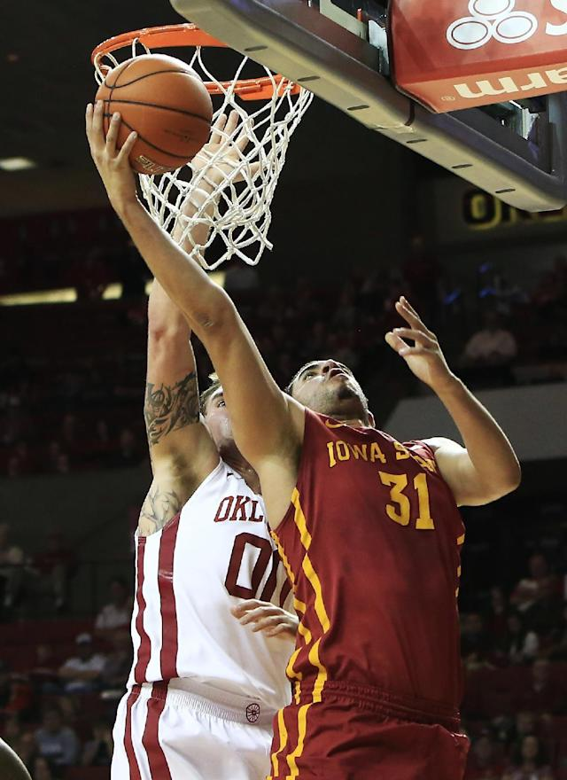 Iowa State guard Georges Niang, right, goes to the basket in front of Oklahoma forward Ryan Spangler during the first half of an NCAA college basketball game in Norman, Okla. on Saturday, Jan. 11, 2014. (AP Photo/Alonzo Adams)